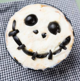 Pizza sauce, pepperoni, ricotta cheese and black olives make up this fun Nightmare Before Christmas Pizza Dip for Halloween or anytime of year!